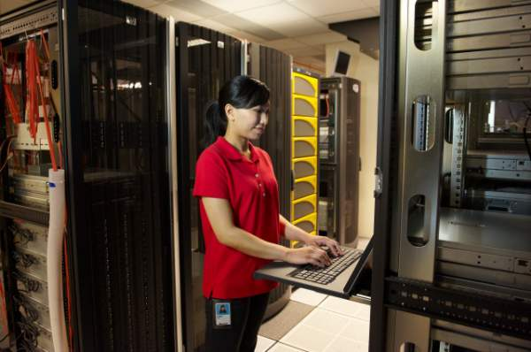 Woman With Laptop At Server Console